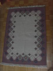 geknüpfter Woll-Teppich